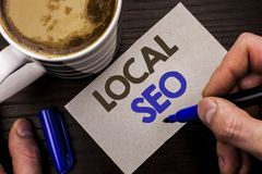 Conceptual hand writing showing Local Seo. Business photo text Search Engine Optimization Strategy Optimize Local Find Keywords wr. Itten Man Holding Marker Note Royalty Free Stock Photography