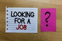 Conceptual hand writing showing Looking For A Job. Business photo text Unemployed seeking work Recruitment Human Resources white p. Age on wooden desk with words stock photography