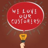 Conceptual hand writing showing We Love Our Customers. Business photo showcasing Appreciation for clients good customer service stock illustration