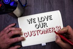 Conceptual hand writing showing We Love Our Customers Call. Business photo showcasing Client deserves good service satisfaction re. Spect Man hold holding red Royalty Free Stock Photo