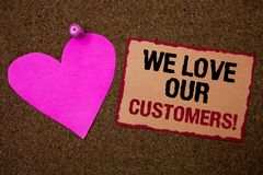 Conceptual hand writing showing We Love Our Customers Call. Business photo showcasing Client deserves good service satisfaction re. Spect Brown rug Ideas message Stock Images