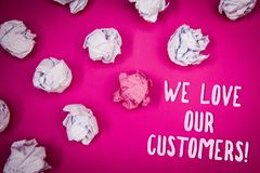 Conceptual hand writing showing We Love Our Customers Call. Business photo text Client deserves good service satisfaction respect. Ideas pink background Stock Image