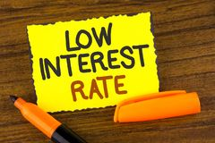 Conceptual hand writing showing Low Interest Rate. Business photo showcasing Manage money wisely pay lesser rates save higher writ. Ten Yellow Sticky note paper stock photography