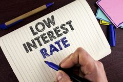 Conceptual hand writing showing Low Interest Rate. Business photo showcasing Manage money wisely pay lesser rates save higher writ. Ten by Man Notebook Book Stock Photo