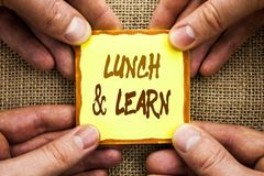 Conceptual hand writing showing Lunch And Learn. Business photo showcasing Presentation Training Board Course written on Sticky No. Conceptual hand writing Stock Image