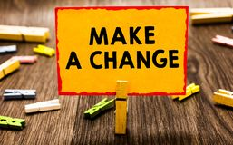 Conceptual hand writing showing Make A Change. Business photo showcasing Create a Difference Alteration Have an Effect Metamorphos. E Clothespin holding orange royalty free stock images