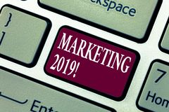 Conceptual hand writing showing Marketing 2019. Business photo showcasing New Year Market Strategies Fresh start. Advertising Ideas Keyboard key Intention to royalty free stock images