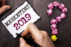 Conceptual hand writing showing Marketing 2019. Business photo text New Year Market Strategies Fresh start Advertising Ideas writt. En by Man Sticky Note Holding stock photo