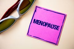 Conceptual hand writing showing Menopause. Business photo text Cessation of menstruation Older women hormonal changes period Stick. Y cards googles glasses royalty free stock photos