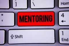 Conceptual hand writing showing Mentoring. Business photo text To give advice or support to a younger less experienced person Keyb. Oard office typing work click royalty free stock photography