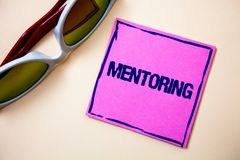 Conceptual hand writing showing Mentoring. Business photo text To give advice or support to a younger less experienced person Stic. Ky cards googles glasses royalty free stock photo