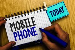 Conceptual hand writing showing Mobile Phone. Business photo showcasing A handheld device used to send receive calls and messages. Man holding marker expressing royalty free stock photography