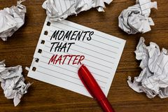 Conceptual hand writing showing Moments That Matter. Business photo showcasing Meaningful positive happy memorable important times. Written white page touched royalty free stock image