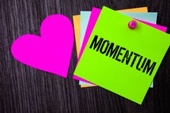 Conceptual hand writing showing Momentum. Business photo text Quantity motion in moving body Product of mass and velocity Pinned m. Ulti colour cards heart stock photo