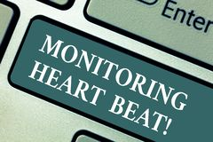 Conceptual hand writing showing Monitoring Heart Beat. Business photo showcasing Measure or record the heart rate in. Real time Keyboard key Intention to create royalty free stock photo