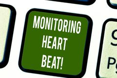 Conceptual hand writing showing Monitoring Heart Beat. Business photo text Measure or record the heart rate in real time. Keyboard key Intention to create stock photos