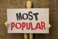 Conceptual hand writing showing Most Popular. Business photo text Top Rating Bestseller Favorite Product or Artist 1st in ranking. Written Cardboard Piece the Stock Photo