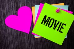 Conceptual hand writing showing Movie. Business photo text Cinema or television film Motion picture Video displayed on screen Pinn. Ed multi colour cards heart Royalty Free Stock Photos