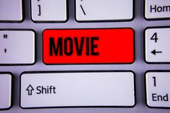 Conceptual hand writing showing Movie. Business photo text Cinema or television film Motion picture Video displayed on screen Keyb. Oard office typing work click Stock Image