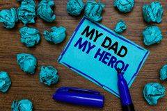 Conceptual hand writing showing My Dad My Hero. Business photo showcasing Admiration for your father love feelings emotions compli. Ment written blue letters on stock images