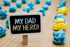 Conceptual hand writing showing My Dad My Hero. Business photo text Admiration for your father love feelings emotions compliment p. Oster board with blurry paper royalty free stock image