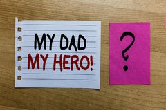 Conceptual hand writing showing My Dad My Hero. Business photo text Admiration for your father love feelings emotions compliment w. Hite page on wooden desk with royalty free stock photos