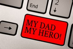Conceptual hand writing showing My Dad My Hero. Business photo text Admiration for your father love feelings emotions compliment G. Reyish silver keyboard with royalty free stock photography