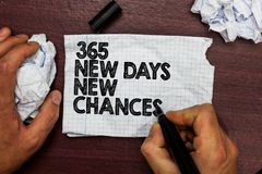 Conceptual hand writing showing 365 New Days New Chances. Business photo text Starting another year Calendar Opportunities Hand ho. Ld pen sketch word on torn royalty free stock images