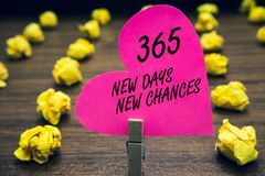 Conceptual hand writing showing 365 New Days New Chances. Business photo text Starting another year Calendar. Opportunities Paperclip hold pink written heart stock image