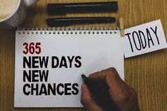 Conceptual hand writing showing 365 New Days New Chances. Business photo text Starting another year Calendar Opportunities Written. On paper hand hold pen stock photography