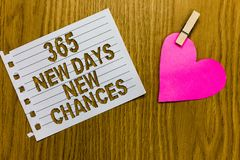 Conceptual hand writing showing 365 New Days New Chances. Business photo showcasing Starting another year Calendar Opportunities Y. Ellow woody deck word with royalty free stock photography