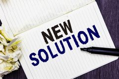 Conceptual hand writing showing New Solution. Business photo text Modern Innovation Latest effective approach to a problem Marker. Over notebook crumpled papers stock image
