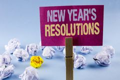 Conceptual hand writing showing New Year\'S Resolutions. Business photo text Goals Objectives Targets Decisions for next 365 days. Written Sticky Note Paper Stock Photo