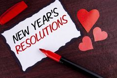 Conceptual hand writing showing New Year'S Resolutions. Business photo text Goals Objectives Targets Decisions for next 365 days. Written Sticky Note Paper Royalty Free Stock Images
