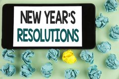 Conceptual hand writing showing New Year\'S Resolutions. Business photo text Goals Objectives Targets Decisions for next 365 days. Written Mobile Phone Screen Royalty Free Stock Image