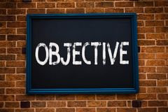 Conceptual hand writing showing Objective. Business photo showcasing Goal planned to be achieved Desired target Company mission Fr. Amed hang black board study royalty free stock photos