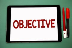 Conceptual hand writing showing Objective. Business photo showcasing Goal planned to be achieved Desired target Company mission Wi. De framed white tablet board stock image
