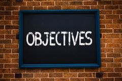 Conceptual hand writing showing Objectives. Business photo showcasing Goals planned to be achieved Desired targets Company mission. S Framed hang black board royalty free stock photography