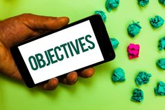 Conceptual hand writing showing Objectives. Business photo text Goals planned to be achieved Desired targets Company missions Text. Message smart screen mobile stock photo