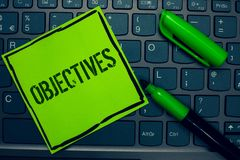 Conceptual hand writing showing Objectives. Business photo text Goals planned to be achieved Desired targets Company missions Keyb. Oard sticky card marker pen stock photography