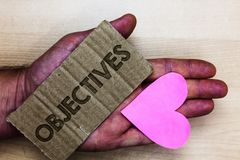 Conceptual hand writing showing Objectives. Business photo text Goals planned to be achieved Desired targets Company missions Pack. Ing card inscribed text love royalty free stock photos