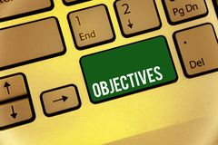 Conceptual hand writing showing Objectives. Business photo text Goals planned to be achieved Desired targets Company missions Keyb. Oard type message idea office royalty free stock photography