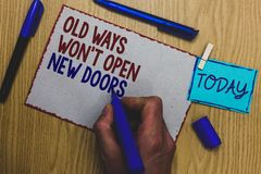 Conceptual hand writing showing Old Ways Won t not Open New Doors. Business photo text be different and unique to Achieve goals Ma. N holding marker paper stock image