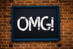Conceptual hand writing showing Omg Motivational Call. Business photo showcasing Oh my good abbreviation Modern Astonishment expre. Ssion Framed hang black board stock photo