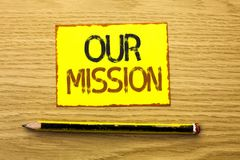 Conceptual hand writing showing Our Mission. Business photo showcasing Goal Motivation Target Growth Planning Innovation Vision wr. Itten Yellow Sticky Note Stock Image