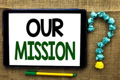 Conceptual hand writing showing Our Mission. Business photo text Goal Motivation Target Growth Planning Innovation Vision written. Tablet the jute background Stock Image