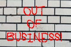 Conceptual hand writing showing Out Of Business. Business photo text Not being working stops operating for financial. Problems Brick Wall art like Graffiti stock photos