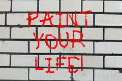 Conceptual hand writing showing Paint Your Life. Business photo text Make your days colorful be cheerful motivated. Inspired Brick Wall art like Graffiti royalty free stock photos