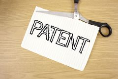 Conceptual hand writing showing Patent. Business photo text License that gives rights for using selling making a product written o. Conceptual hand writing stock photos