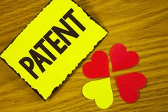 Conceptual hand writing showing Patent. Business photo text License that gives rights for using selling making a product written o. Conceptual hand writing stock images